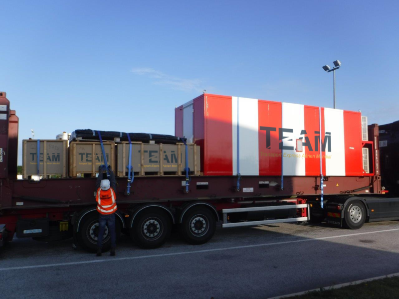 Container and wooden box on a TEAM delivery truck in Equatorial Guinea